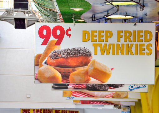 Billboard of advertisement for 99 cent deep fried twinkies
