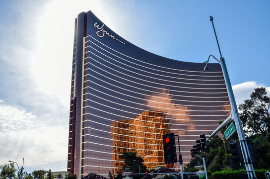 Curved Wynn hotel architecture with reflection and street traffic lights in Las Vegas