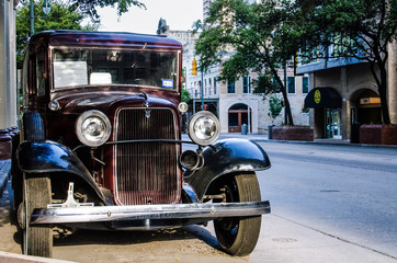 Old 1934 Ford Panel Delivery Truck showcased outside the Driskill hotel in downtown