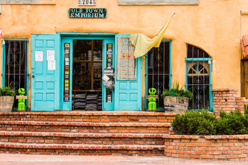 Albuquerque, USA - July 28, 2015: Old town plaza at hidden patio with Emporium shop and decorative sidewalk with brick paths and gardens