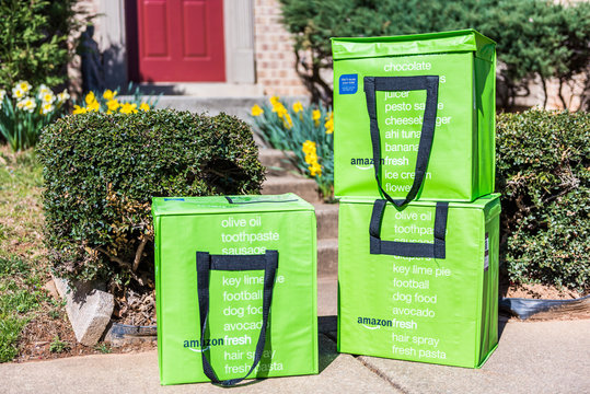Fairfax, USA - March 2, 2017: Amazon Fresh insulated grocery delivery bags on front porch closeup
