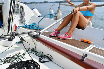 A female skipper as she tie the sailboat