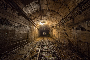 Gold iron mine ore shaft tunnel drift with rails underground