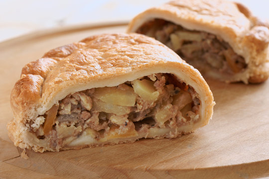 Traditional English Cornish pasty filled with meat potatoes and swede