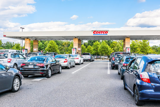 Fairfax, USA - September 8, 2017: People in cars waiting in long line queue lanes to fill up vehicles with gas, gasoline, petroleum at Costco store in Virginia