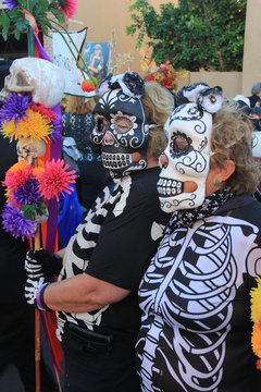 women wearing skull masks skeleton costumes halloween dia de los muertos