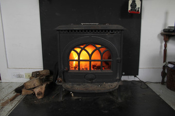fire in the wood stove fireplace