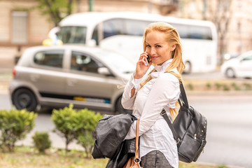 A woman talking on her phone while walking