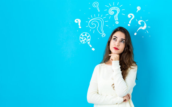 Question marks with young woman in a thoughtful face