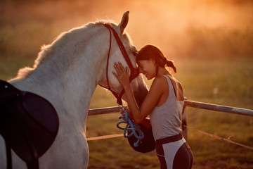 Girl love hourse. Woman and her horse on a sunset. Wall mural