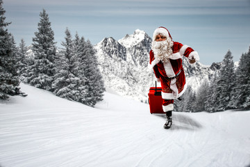 Saint Nicholas with a red suitcase. Elderly man with a beard delivers presents to children....