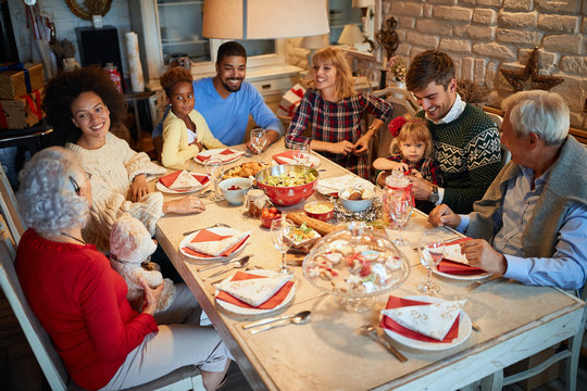 Family and friends at  Christmas dinner.Christmas eve with traditional food.