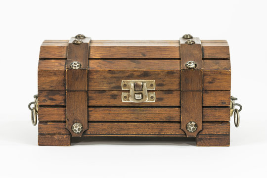 Old wood toy treasure chest on white.