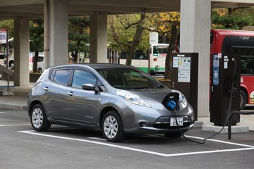 NARA, JAPAN - NOVEMBER 23, 2016: Nissan Leaf electric car charging at a station in Nara, Japan. Zero-emissions vehicles have improved vastly in recent years.