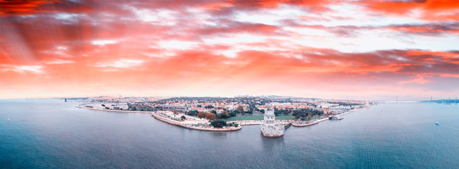 Panoramic aerial view of Lisbon Belem Tower and cityscape at sunset