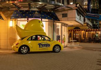 Peeps brand yellow Volkswagen beetle at National Harbor