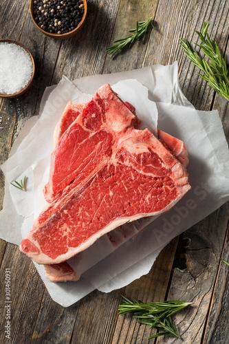 Wall mural Raw Red Grass Fed T Bone Steak