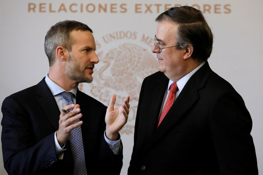 CEO of the U.S. Overseas Private Investment Corporation (OPIC) Adam S. Boehler and Mexico's Foreign Minister Marcelo Ebrard chat during the signing of a letter of interest to support critical energy Infrastructure in Southern Mexico, in Mexico City