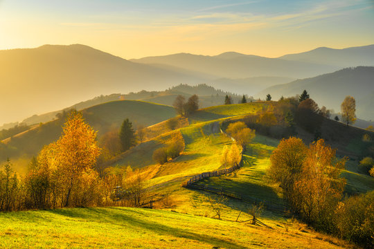 Autumn landscape with mountains at sunset