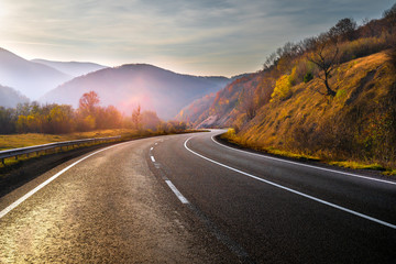 Highway in mountains in autumn evening Fototapete