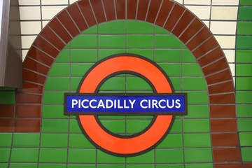 LONDON, UK - JULY 6, 2016: London Underground station sign at Piccadilly Circus, London. London Underground is the 11th busiest metro system worldwide with 1.1 billion annual rides.