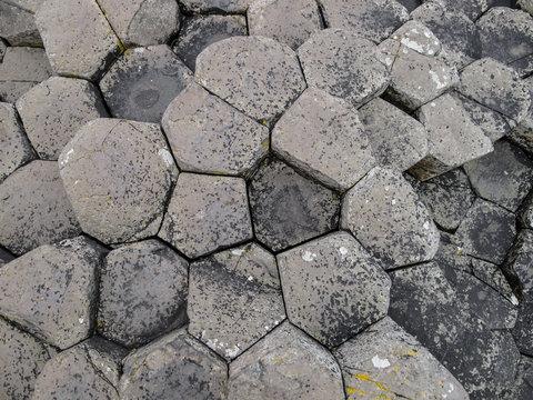 Aerial view pattern of hexagonal basalt columns on the Giants Causeway in Northern Ireland