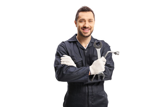 Mechanic holding car repair equipment