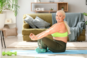 Body positive woman training at home