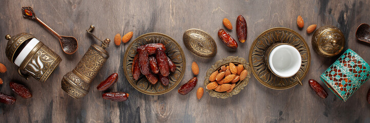 Dried dates and coffee on a dark background.Arabic traditional dishes, pots and dates fruits. Ramadan Kareem, Eid mubarak concept. Top view. Flat lay. Copy space