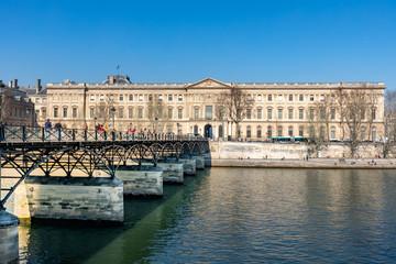 27 FEB 2019 - Paris, France - The pont des Arts and the Louvre Palace