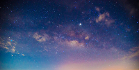 Panorama blue night sky milky way and star on dark background.Universe filled, nebula and galaxy with noise and grain.Photo by long exposure and select white balance.Dark night sky. Fotomurales