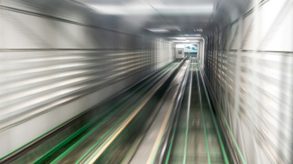Motion blur of train moving inside tunnel. Move to goal or target concept.