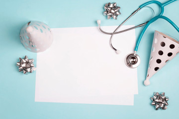Doctor's or nurse day greeting card with stethoscope and festive caps on blue background.