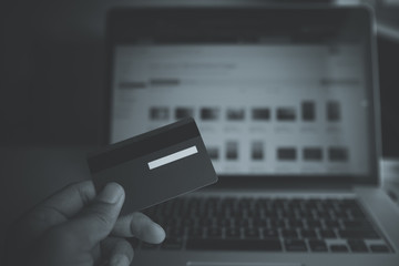 Comfort e-commerce shopping. Royalty high quality free stock photo image of shopping online and payment by credit card. Using laptop and mobile phone to online shopping and pay by credit card
