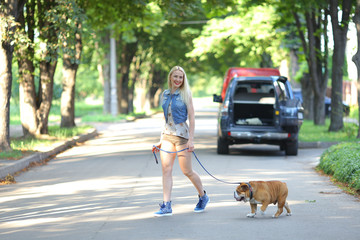 Young beautiful woman girl lady blond hair with red lips in casual style american bulldog.