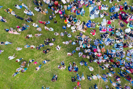 Tatarstan, Russia, July 10, 2019: large crowds in nature. Men, women and children sitting on the grass. Shooting from a drone. The view from the top.