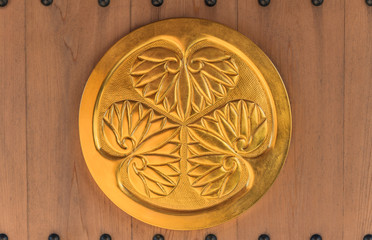 Golden coat of arms of the Shogun clan Tokugawa of ancient capital Edo which symbolizes three leaves of hollyhocks.