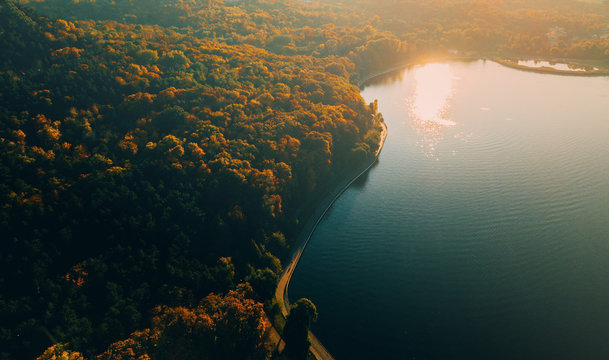 Aerial drone shot of beautiful landscape with lake in park, cityscape, blurry image