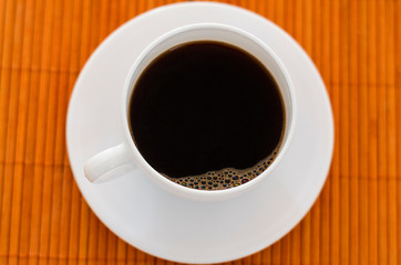 Top view of a white coffee cup on the table