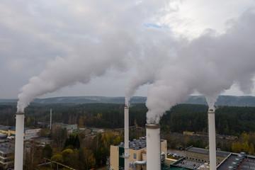Smoking chimneys on the late autumn sky background. Heating season.