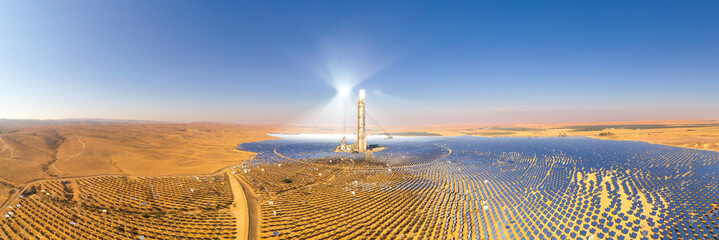 Solar power tower and mirrors that focus the sun's rays upon a collector tower to produce renewable, pollution-free energy, Aerial