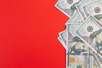 United States or USA 100 dollar currency on a red background and copy space.  Fake money and financial fraud concept.