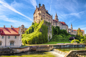 Fototapete - Sigmaringen Castle on rock, Germany. This famous Gothic castle is landmark of Baden-Wurttemberg. Scenery of old German castle by Danube river in summer. Scenic view of amazing medieval palace.