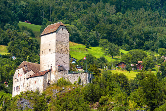Sargans castle in St Gallen canton, Switzerland. Scenic view of Swiss castle on background of mountain forest and village.