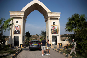 """People make their way to visit the """"Island of Peace"""" in an area known as Naharayim in Hebrew and Baquora in Arabic, on the Jordanian side of the border with Israel"""