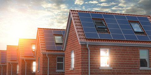 Row of house with solar panels on roof  on blue sky background.