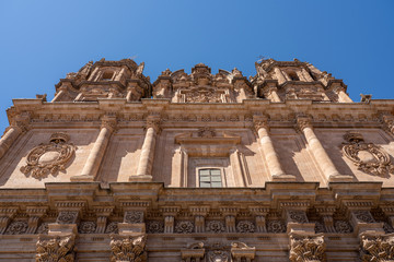 Ornate stone carvings on the Clericia church or cathedral in Salamanca Spain