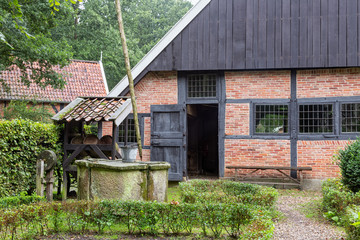 Dutch rural open-air museum with shed and water well