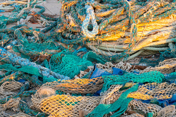 dirty old rope and nets for fishing on the dock