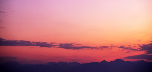 Wall Mural - Orange sky over silhouette mountain in the morning.